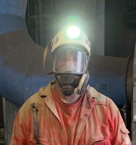 Man with helmet an light on